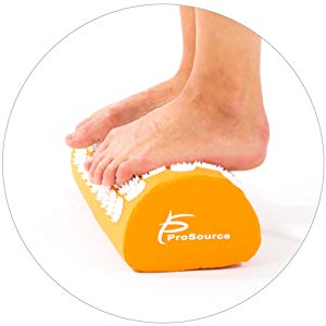 image may include a set of feet on an acupressure pillow